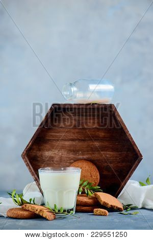 Milk And Cookies With A Bottle And Wooden Tray. High Key Food Photography On A Concrete Background W