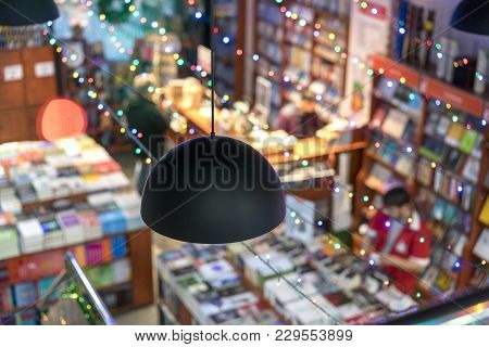 Blurred Abstract Background Of Book On Bookstore. Blurry Bookshelf In Library Room For Your Backgrou