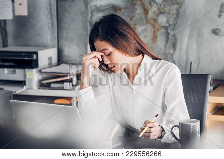 Frustrated Asian Businesswoman Cover Her Face With Two Hand And Feel Upset From Work In Front Of Lap