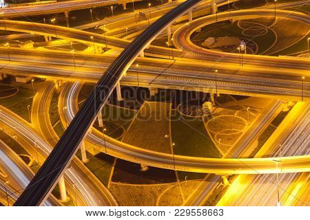 DUBAI, UAE - FEBRUARY 2018: Night traffic on a busy intersection on Sheikh Zayed highway