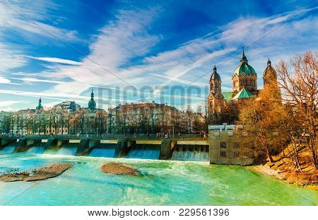 View On Winter Landscape By Turquoise Isar And St. Anna Church In Munich