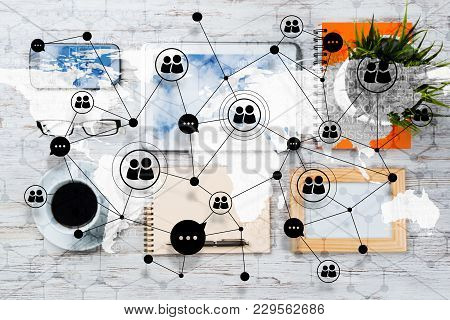 Top View Of Modern Workplace With Office Stuff And Global Map With Social Connections Above. Mixed M