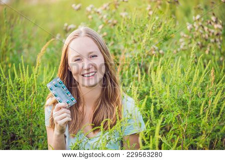 Young Woman Holds In Her Hand Allergy Tablets Because Of An Allergy To Ragweed.