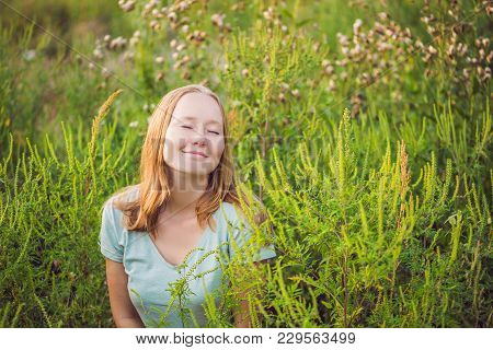 Young Woman Happy Because No Longer Feels Allergic To Ragweed.