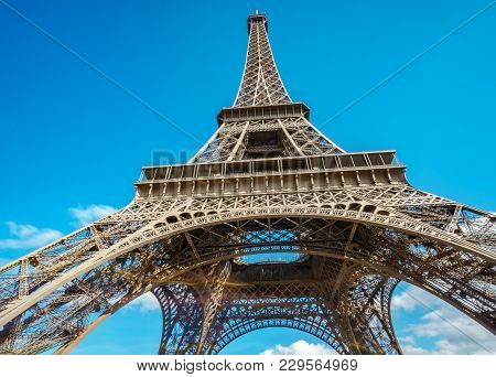 Ultra Wide Angle Of Eiffel Tower Over Blue Sky In Paris, France. Worms Eye View