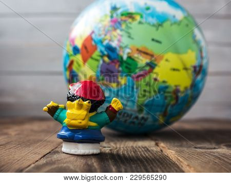 A Toy On The Background Of The Earth