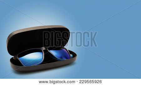 Open Protective Case With Sunglasses. On Color Background.
