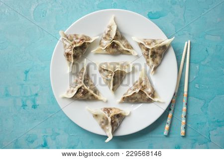 Delicious Oriental Dim Sum Dumplings Homemade On The Blue Background