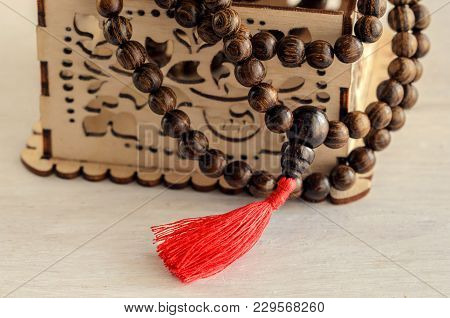 Old wooden mala beads, essential accessory for meditation or mindfulness.