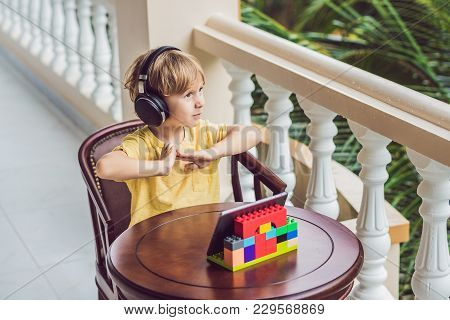 Cute Boy In The Tropics Talking With Friends And Family On Video Call Using A Tablet And Wireless He