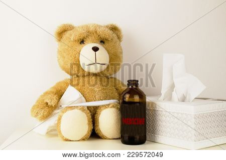 Plush bear is sick, has  rhinitis and temperature.Plush bear with thermometer, MEDICINE bottle with inscription syrup and paper tissues. poster