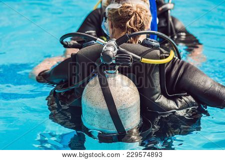 Grey Scuba Diving Air Oxygen Tank On The Back Of A Scuba Diver.