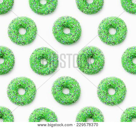 Collage Of Green Doughnuts In Glaze On A White Background. Lots Of Donuts Mosaic, A Tasty Fresh Gree