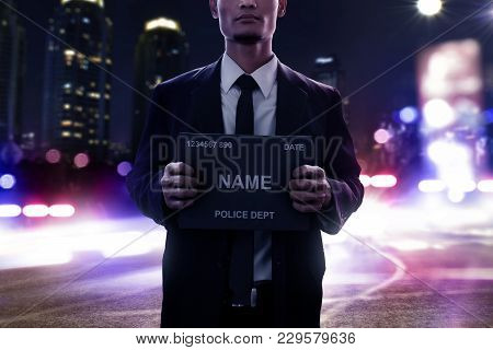 Mugshot Of Criminal On The Streets At Night