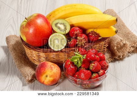 Fresh Strawberries  In The Glass Bowl Topped Mint Leaves, Nectarine, Lime, Kiwi, Banana, Apple In A