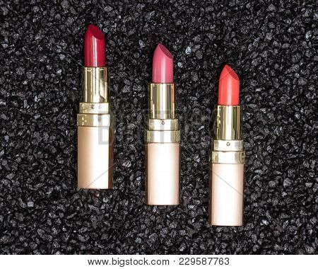 Different Colors Of Lipstick On Anthracite Background. Trendy Lip Make-up