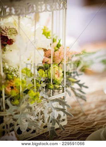 The Yellow Rose In The Birdcage On The Wedding Decoration