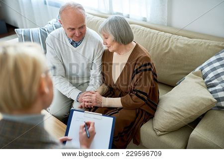 Portrait Of Nice Senior Couple Visiting Psychologist Sharing Problems In Therapy Session