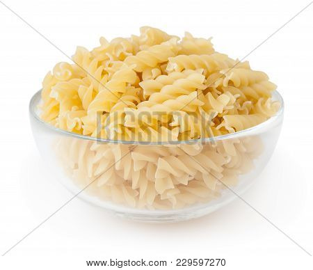 Uncooked Fusilli Pasta In Glass Bowl Isolated On White Background