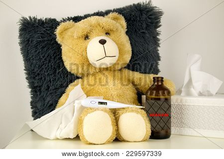 Plush Bear Is Sick, Has  Rhinitis And Temperature 39°c.plush Bear With Thermometer And Bottle With M