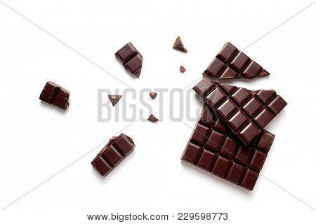 Chunks of Dark Chocolate On White Background.