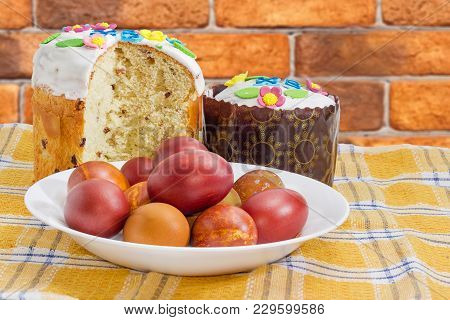 One Whole And One Partly Cut Easter Cakes Decorated With White Icing And Colorful Sugar Decors, Dish