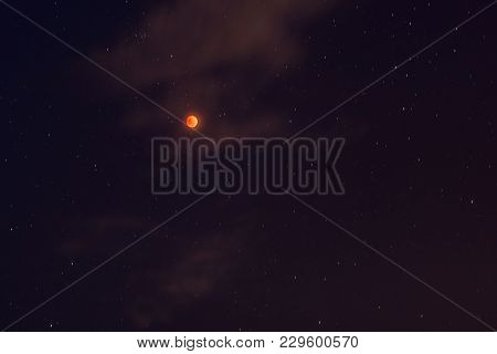 Blood Moon Concept Of A Red Full Moon Against A Black Sky.