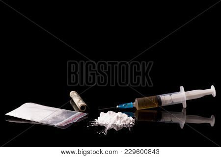 Cocaine, Herion Or Other Illegal Drugs That Are Sniffed By Means Of A Tube Or Injected With A Syring