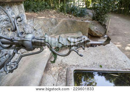 Barcelona,spain-april 8,2014: Fountain Or Font Hercules, Designed By Antoni Gaudi. Located In Garden