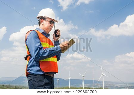 Male Architect Or Engineer Use Two Way Radio And Tab;et