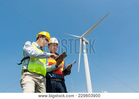 Engineer And Architect Discuss Over Digital Wireless Tablet And Clipboard