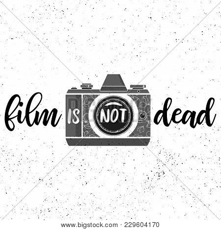 Film Is Not Dead.black And White Print With Film Photocamera On Grunge Background.