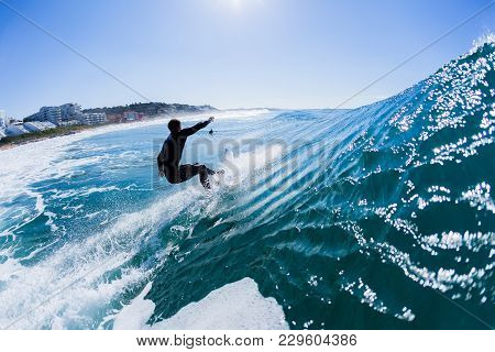 Surfing Surfer  Rides Ocean Wave Rear Water Action Photo Unidentified.