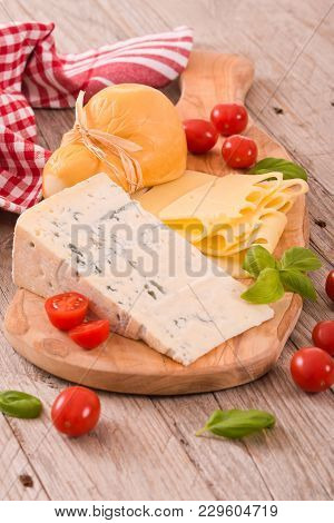 Various Types Of Italian Cheeses On White Dish.