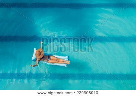 Enjoying Suntan. Vacation Concept. Top View Of Slim Young Woman In Bikini On The Blue Air Mattress I
