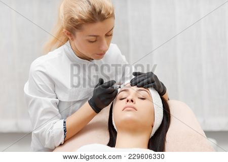 Cosmetologist Doing Beauty Procedure For Patient.