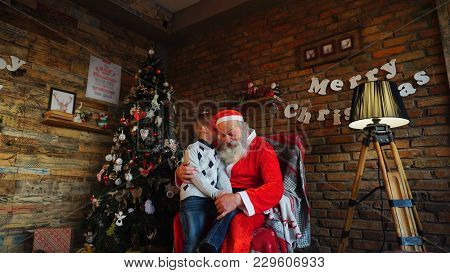 Santa Claus Presents Gift To Happy Boy..