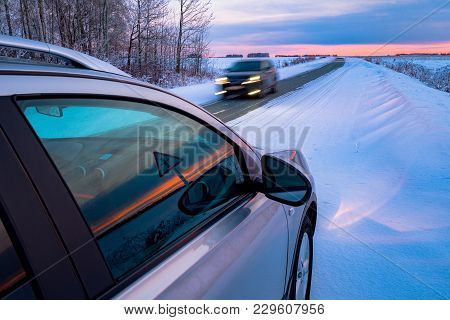Driving Suv Car In Winter On Forest Road With Much Snow. Oncoming Car At A Dangerous Speed. Dangerou