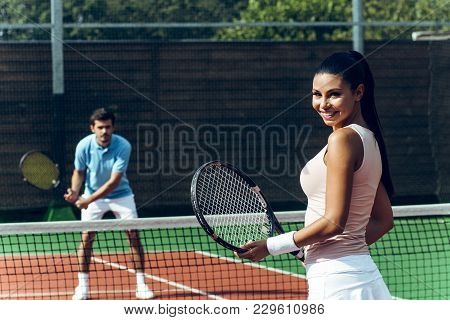 Next Tennis Game I Will Play With You! Beautiful Young Couple Playing Tennis On The Tennis Court Wit