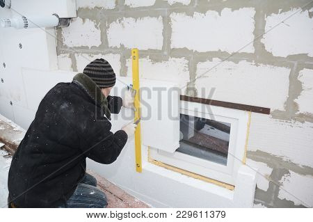 Kyiv, Ukraine - March, 15, 2018: Building Contractor Insulating House Wall With Styrofoam Insulation