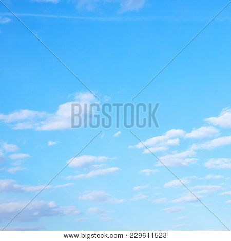 White clouds in spring sky, may be used as background