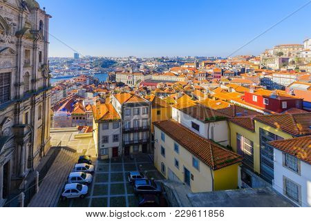 View Of The Church Of St. Lawrence, The Douro River, And The Old Center Of Porto, Portugal