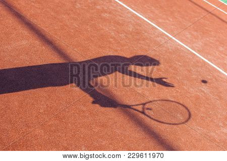 Sunny Tennis. Shadow Of Young Man Playing Tennis On The Tennis Court.