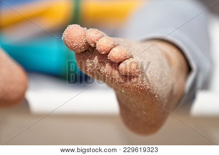 Happy Bare Feet On Sandy Beach. Feet Covered In Sand. Sunny. Shallow Depth Of Field.