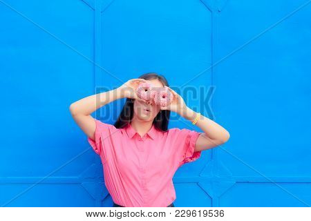 Funny Girl Holding Doughnuts In Front Of Her Eyes