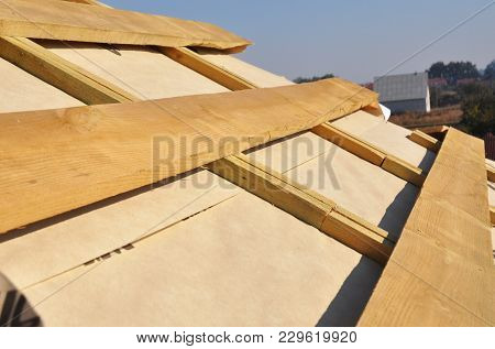 Roof Waterproofing Membrane Coverings. Wooden Construction Home Framing With Roof Rafters.
