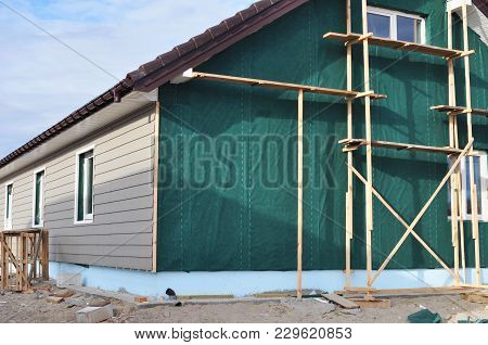 Building House With Wall Insulation, Waterpfoof Membrane, Plastic Siding, Guttering And Foundation I