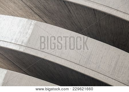Abstract Contemporary Architecture Background. Round Concrete Exterior Fragment With Dark Niches
