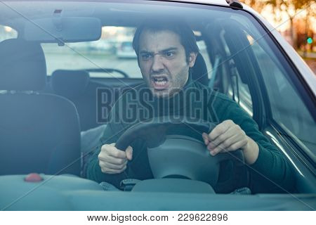 Angry Man Driver Pissed Off By Drivers In Front Of Him And Gesturing With Hands