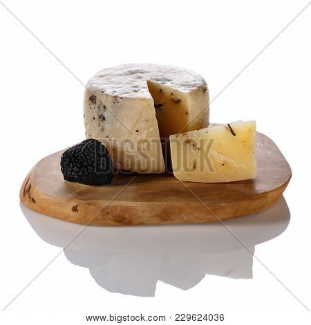 Hard Truffle Cheese And Black Truffles On A Cutting Board Isolated On White.
